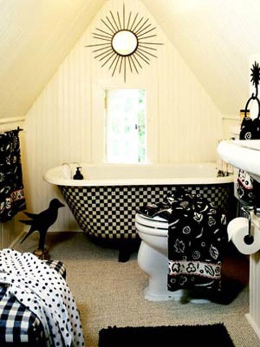 Dica de decoração de banheiro no sotão com banheira vitoriana preta e branca